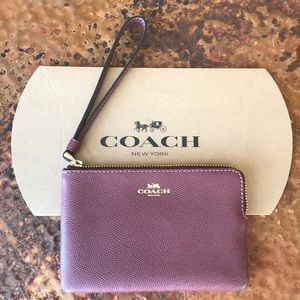 COACH Plum Wristlet. Gold Zipper. New with tags.